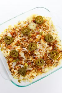 Top mac and cheese with garnish